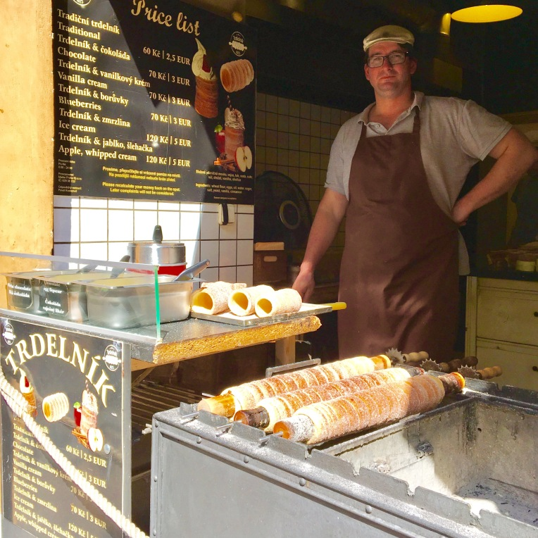 Trdelnik stand - long ribbon of dough wrapped around a stick and roasted on a rotisserie